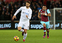 Fernando Llorente of Swansea City FC is chased down by Dimitri Payet of West Ham United during the Premier League match between Swansea City and West Ham United at The Liberty Stadium, Swansea, Wales, UK. 26 December 2016