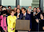 United States Senate Majority Leader Bob Dole (Republican of Kansas), the presumptive 1996 Republican Party candidate for President of the United States, announces he will resign his seat in the US Senate on or before June 11, 1996 to concentrate on his presidential campaign in Washington, DC on Wednesday, May 15, 1996.  Looking on at left is Dole's wife Elizabeth Dole.<br /> Credit: Arnie Sachs / CNP