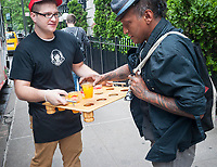 Workers for Wendy's distribute samples of their FruiTea Chillers on Monday, June 5, 2017 in advance of National Iced Tea Day on Saturday. The beverages are a collaboration with Honest Tea and use real fruit juice as flavoring. Coca-Cola has owned 100 percent of Honest Tea since 2011 when they exercised their option to purchase the remainder of the company that they had a stake in.(© Richard B. Levine)