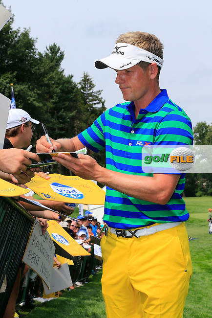 Luke Donald (ENG) signs autographs on the practice range during Wednesday's Practice Day of the 95th US PGA Championship 2013 held at Oak Hills Country Club, Rochester, New York.<br /> 7th August 2013.<br /> Picture: Eoin Clarke www.golffile.ie