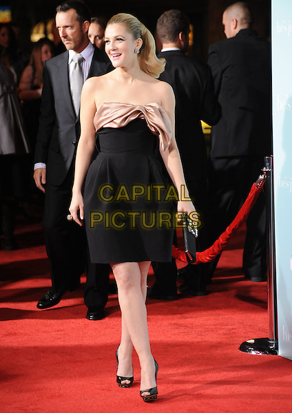 "DREW BARRYMORE.""He's Just Not That Into You"" Los Angeles Premiere at Grauman's Chinese Theatre, Hollywood, California, USA..February 2nd, 2009.full length black strapless dress bow beige silk satin open toe shoes .CAP/DVS.©Debbie VanStory/Capital Pictures."