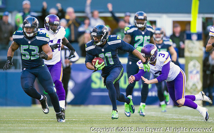 Seattle Seahawks  wide receiver Percy Harvin runs back a 57 yard kickoff return against the  Minnesota Vikings  at CenturyLink Field in Seattle, Washington on  November 17, 2013.  The Seahawks beat the Vikings 41-20.  ©2013.  Jim Bryant. All Rights Reserved.