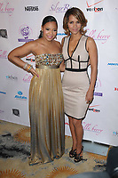 Ashanti, Halle Berry<br /> 2009<br /> Silver Rose Gala - Beverly Hills Hotel<br /> Showest_Las Vegas, Nevada<br /> Photo By Russell EInhorn/CelebrityArchaeology.com