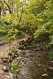 USA, Oregon, Ashland, a man takes a walk in Lithia Park along the Lithia River