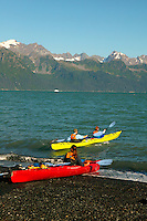 Kayaking on Resurrection Bay with the Chugach National Forest in the background, from Lowell Point, near Seward, Alaska