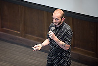 """Jedidiah Jenkins, executive editor of Wilderness Magazine, talks about """"How to Slow Down the Passing of Time.""""<br /> Occidental College's second TEDx event, Choi Auditorium, April 2, 2016. Featuring talks on sustainability and global development by speakers that included five students, a faculty member and seven external speakers.<br /> (Photo by Marc Campos, Occidental College Photographer)"""