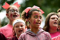 NWA Democrat-Gazette/DAVID GOTTSCHALK Jade Newton (center), a sixth grade student at Lincoln Middle School, sings Friday, October 4, 2019, with the choir during the 44th Annual Arkansas Apple Festival on the downtown square in Lincoln. The festival, that runs through Sunday, will feature activities that include a parade, apple core throwing and both bluegrass and gospel music.