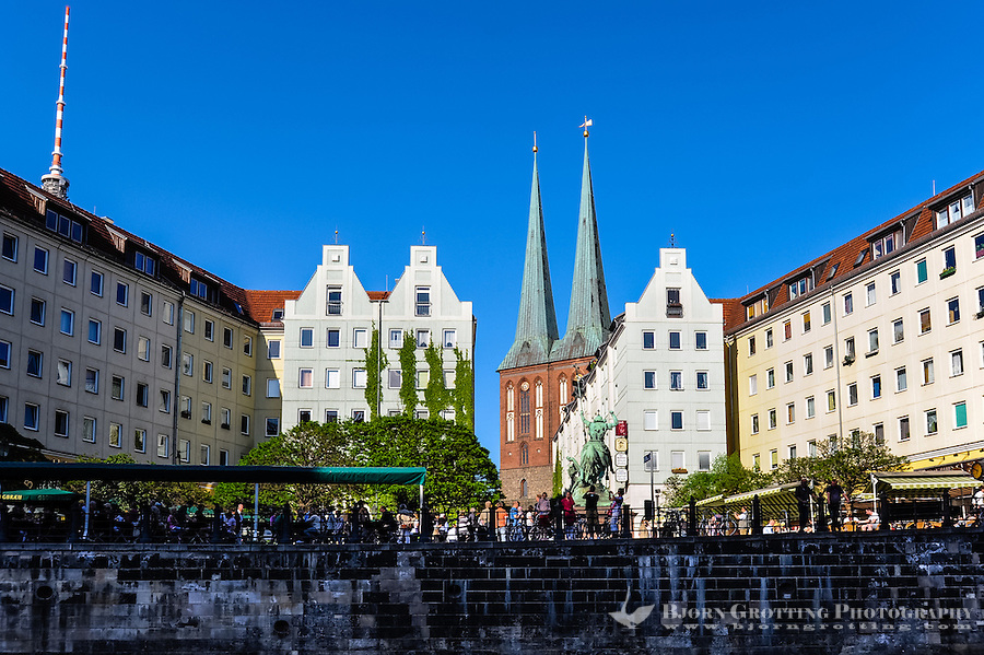 Berlin, Germany. Nikolaiviertel, Nikolai Quarter, is the reconstructed historical heart of the city. St. Nikolai-Kirche in the background.