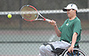 Nate Melnyk of Harborfields returns a volley during a third doubles varsity boys tennis match against host Smithtown High School East on Tuesday, Apr. 29, 2016. The wheelchair-using junior played in his first varsity match, which was suspended in the first set due to rain. The match is set to resume on Monday, May 2.