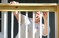 NWA Democrat-Gazette/DAVID GOTTSCHALK  James McAnear, of McAnear Painting of Bentonville, paints the railings of a deck Tuesday, September 29, 2015 of a home for painting in Bentonville. McAnear was painting the trim on both the interior and exterior of the home.