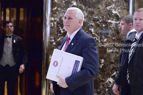 United States Vice President -elect Mike Pence talks to reporters in the lobby of the Trump Tower in New York, New York, on November 28, 2016. <br /> Credit: Anthony Behar / Pool via CNP