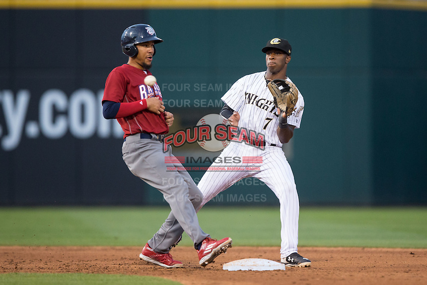 Charlotte Knights shortstop Tim Anderson (7) waits for a pick-off throw as J.P. Crawford (3) of the Lehigh Valley Iron Pigs returns to second base at BB&T BallPark on June 3, 2016 in Charlotte, North Carolina.  The Iron Pigs defeated the Knights 6-4.  (Brian Westerholt/Four Seam Images)