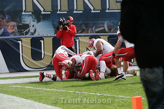 Trent Nelson  |  The Salt Lake Tribune.Utah players dog pile on Derrick Shelby after he pulled down an interception and dove into the end zone for a second half touchdown. Utah vs. Pitt, college football at Heinz Field Stadium in Pittsburgh, Pennsylvania, Saturday, October 15, 2011. Skip