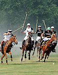 (L) Prince Harry and Nacho Figueras (Caption of the Black Watch team) competing at the 3rd Annual Veuve Clicquot Polo Classic on Governors Island on June 27, 2010.