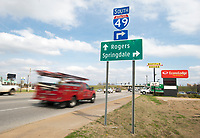 NWA Democrat-Gazette/CHARLIE KAIJO Cars drive by, Friday, March 23, 2018 on Walnut Ave. west of the I-49 in Rogers. <br /><br />Rogers Mayors Greg Hines says the city will ask voters to extend the sales tax to pay for another package of street improvement bonds. Rogers voters approved a bond issue in 2011 that included more than $100 million for streets plus money for parks and other amenities.