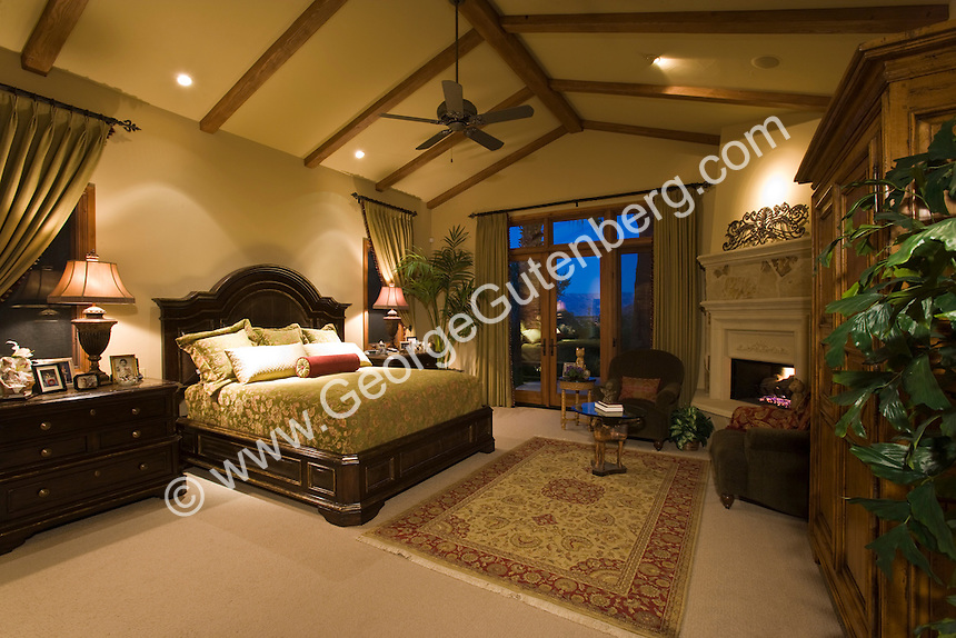 Luxurious Master Suite With Vaulted Ceiling And Elegant Furniture Is Seen At Night Stock Photo Of