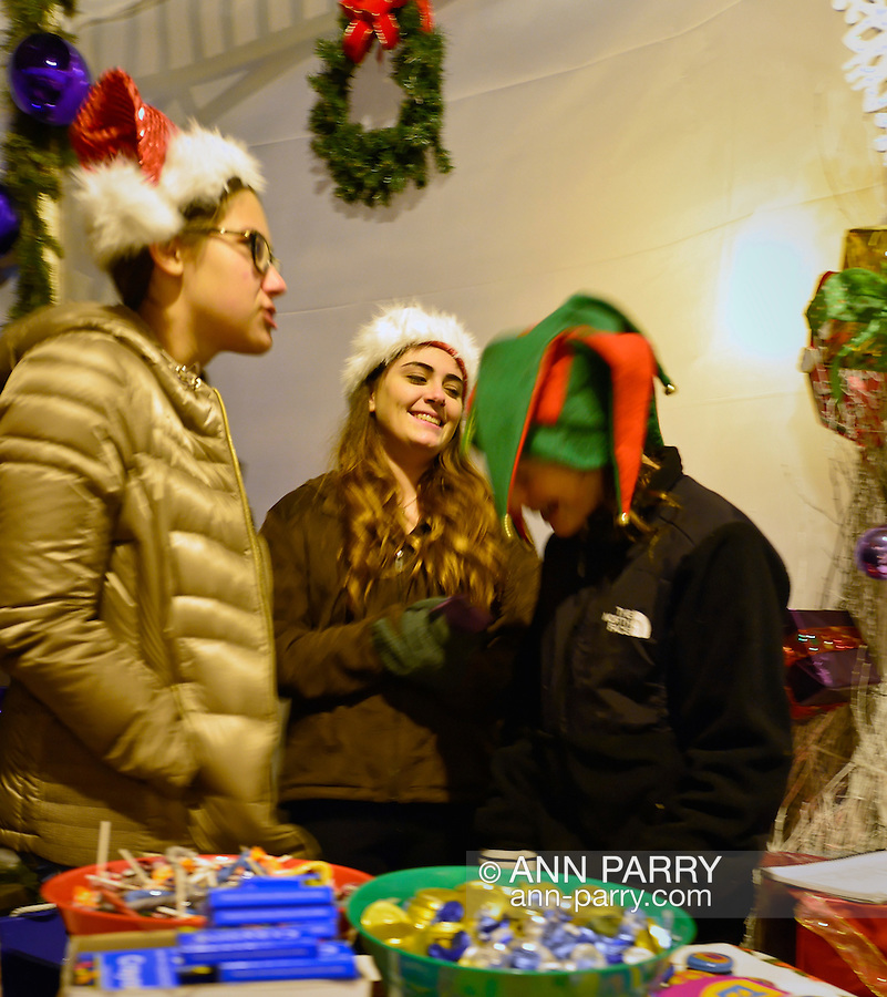 Merrick, New York, USA. December 7, 2014. Merrick Christmas Tree and Menorah Lighting at Gazebo by LIRR Train Station. Local government officials attended the event hosted by the Merrick Chamber of Commerce, and there was free hot chocolate, cookies and other snacks for visitors.