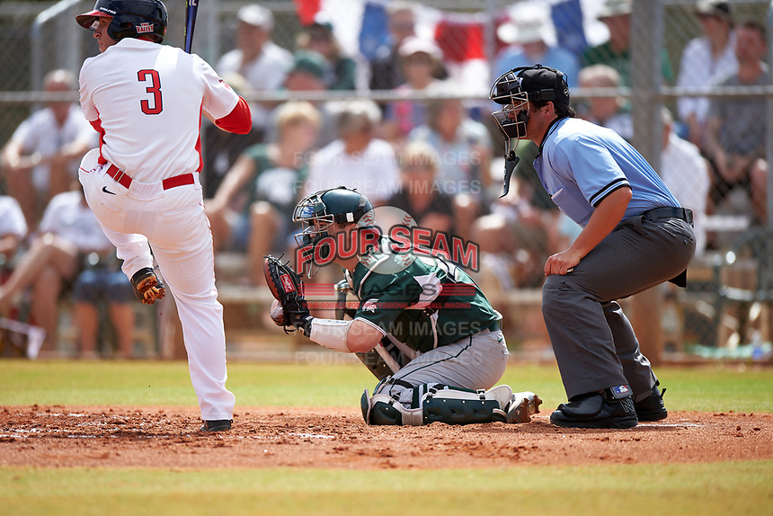 Michigan State Spartans catcher Chad Roskelly (24) and umpire Mike Savakinas await the pitch as Joe Kelch (3) is at bat during a game against the Illinois State Redbirds on March 8, 2016 at North Charlotte Regional Park in Port Charlotte, Florida.  Michigan State defeated Illinois State 15-0.  (Mike Janes/Four Seam Images)