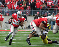 "November 22, 2008. Ohio State running back Chris ""Beanie Wells (28) follows a block by left guard Steve Rehring. The Ohio State Buckeyes defeated the Michigan Wolverines 42-7 on November 22, 2008 at Ohio Stadium, Columbus, Ohio."