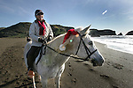 Horse riding on Rodeo Beach at Fort Cronhkite in Marin County.