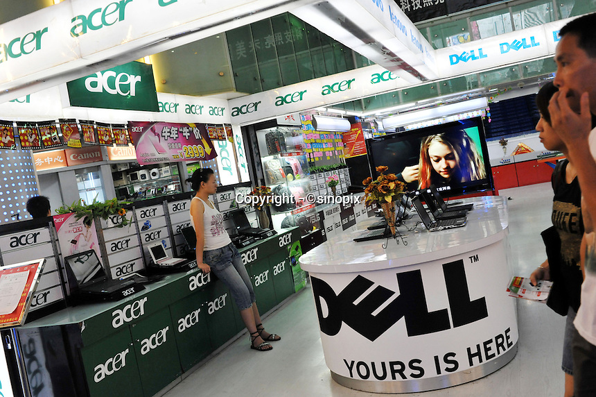 A shop selling Acer and Dell computers in Guangzhou, China. The financial crisis won't have too much impact on Chinese consuming market. According to a survey by Nielsen of 50 countries and regions, only 35 percent of Chinese people believed the domestic economy was in a contraction. The figure was the lowest among the 50 world markets..