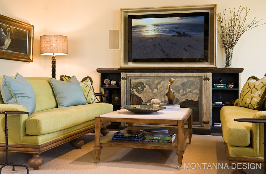 Greens and blues for a beach house vibe complement the beautiful art painted TV cabinet