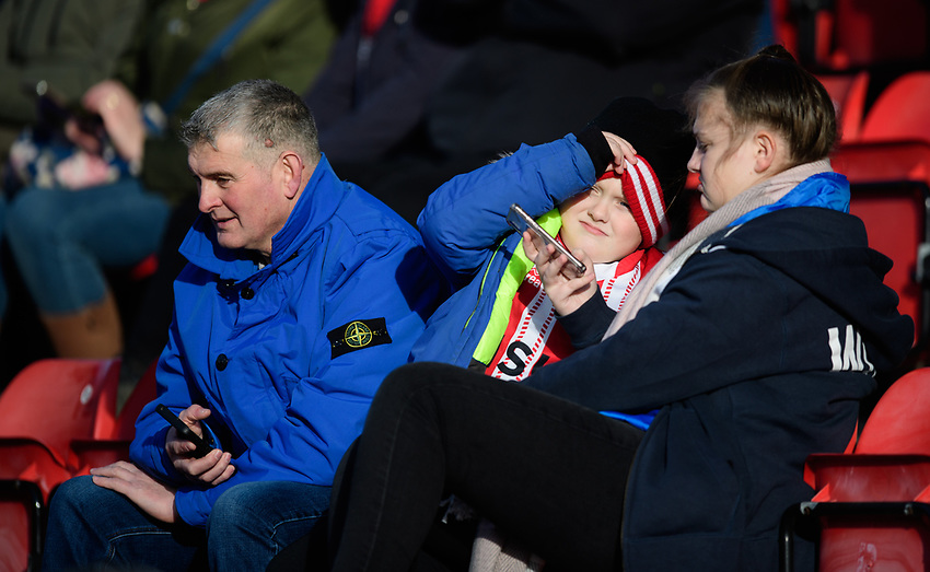 Lincoln City fans enjoy the pre-match atmosphere<br /> <br /> Photographer Chris Vaughan/CameraSport<br /> <br /> The EFL Sky Bet League Two - Lincoln City v Northampton Town - Saturday 9th February 2019 - Sincil Bank - Lincoln<br /> <br /> World Copyright © 2019 CameraSport. All rights reserved. 43 Linden Ave. Countesthorpe. Leicester. England. LE8 5PG - Tel: +44 (0) 116 277 4147 - admin@camerasport.com - www.camerasport.com