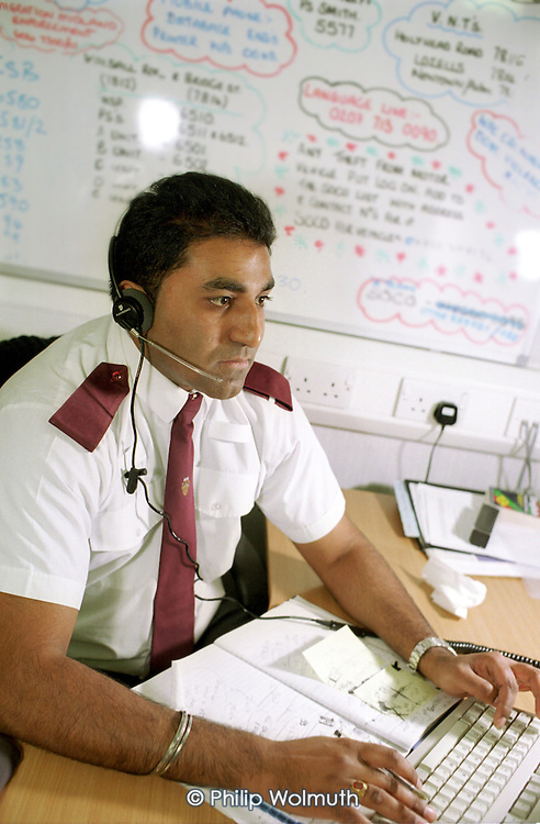 Civilian West Midlands Police Service call handler at Steelhouse Lane Police Station, Birmingham.