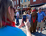 Tracy Nicholas (left) takes a photo of her friend Bobbie Haven - dressed as a Wookie - with Shira Ortega and Scot Lang of Alton, IL at the 11th Annual World Naked Bike Ride which was held Saturday in The Grove. Hundreds of participants wore nothing or next to nothing before, during and after the bicycle ride. There was also a costume contest, a drag show, music, food, vendor booths, and dancing.   Photo by Tim Vizer