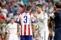 Cristiano Ronaldo of Real Madrid and Siqueira of Atletico de Madrid during La Liga match between Real Madrid and Atletico de Madrid at Santiago Bernabeu stadium in Madrid, Spain. September 13, 2014. (ALTERPHOTOS/Caro Marin)