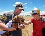 Prairie Meadows celebrated Fathers Day with its first ever first Wiener Dog Races. The four-legged competitors and their owners hit the starting gate in a 30-yard dash for cash prizes and a shot at the Wiener's Circle. Mike Benson and his son Jake congratulate Oscar for finishing first in his heat.