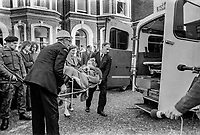 Following Provisional IRA bombing of Lavery's Bar, Lisburn Road, Belfast, N Ireland, 21st December 1971 woman is stretchered to a waiting ambulance. The bar owner, John F Lavery, aka, Jack Lavery, died as he attempted to remove the bomb from the bar. 197112210514G.<br /><br />Copyright Image from Victor Patterson, 54 Dorchester Park, <br />Belfast, UK, BT9 6RJ<br /><br />t1: +44 28 9066 1296 (from Rep of Ireland 048 9066 1296)<br />t2: +44 28 9002 2446 (from Rep of Ireland 048 9002 2446)<br />m: +44 7802 353836<br /><br />victorpatterson@me.com<br />victorpattersonbelfast@gmail.com<br /><br />Please see my Terms and Conditions of Use at victorpatterson.com. It is IMPORTANT that you familiarise yourself with them.<br /><br />Images used on the Internet incur an additional cost and must be visibly watermarked i.e. &copy;Victor Patterson within the body of the image and copyright metadata must not be deleted. Images used on the Internet have a size restriction of 4kbs and are chargeable at rates available at victorpatterson.com.<br /><br />This image is available only for the use of the download recipient i.e. television station, newspaper, magazine, book publisher, etc, and must not be passed on to any third party. It is also downloaded on condition that each and every usage is notified within 7 days to victorpatterson@me.com<br /><br />The right of Victor Patterson (or the named photographer) to be identified as the author is asserted in accordance with The Copyright Designs And Patents Act (1988). All moral rights are asserted.