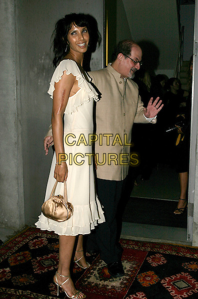 PADMA LAKSHMI & SALMAN RUSHDIE .Salman Rushdie Book Launch at the David Gill Gallery, London, SW11..September 7th, 2005.full length married husband wife walking beige suit jacket white dress summery ruffles gold purse.www.capitalpictures.com.sales@capitalpictures.com.© Capital Pictures.