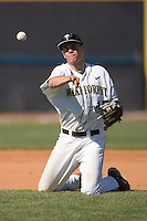 Shortstop Shane Kroker #10 of the Wake Forest Demon Deacons makes a throw to first from his knees versus the Virginia Cavaliers at Wake Forest Baseball Park March 8, 2009 in Winston-Salem, NC. (Photo by Brian Westerholt / Four Seam Images)