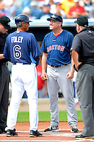 Boston Red Sox coach Gary DiSarcina #46 and Tom Foley #6 before a Grapefruit League Spring Training game against the Tampa Bay Rays at Charlotte County Sports Park on February 25, 2013 in Port Charlotte, Florida.  Tampa Bay defeated Boston 6-3.  (Mike Janes/Four Seam Images)