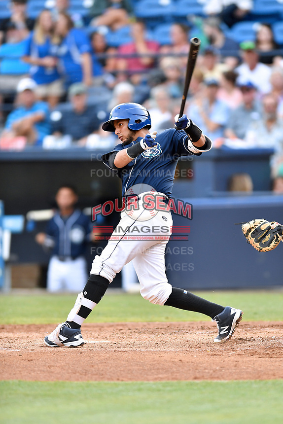 Asheville Tourists catcher Joel Diaz (5) swings at a pitch during a game against the Charleston RiverDogs at McCormick Field on July 6, 2017 in Asheville, North Carolina. The Tourists defeated the RiverDogs 13-9. (Tony Farlow/Four Seam Images)