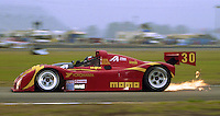 The #30 Ferrari 333 SP of Gianpero Moretti, Bob Wollek, Didier Theys and Max Papis races to a second place finish in the 24 ours of Daytona, IMSA race, Daytona INternational Speedway, Daytona Beach , FL, February 4, 1996.  (Photo by Brian Cleary/www.bcpix.com)