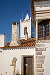 Church tower and architectural details of buildings inside historic walled hilltop village of Monsaraz, Alto Alentejo, Portugal, southern Europe