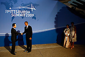Pittsburgh, PA - September 24, 2009 -- United States President Barack Obama (2L) greets South Korean President Lee Myung-bak (L) as U.S. first lady Michelle Obama (R) waits with Korean first lady Kim Yoon-ok at the Phipps Conservatory on Thursday, September 24, 2009 in Pittsburgh, Pennsylvania. Heads of state from the world's leading economic powers arrived today for the two-day G-20 summit held at the David L. Lawrence Convention Center aimed at promoting economic growth. .Credit: Win McNamee / Pool via CNP