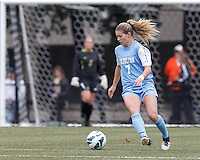 University of North Carolina forward Kealia Ohai (7) brings the ball forward.   University of North Carolina (blue) defeated Boston College (white), 1-0, at Newton Campus Field, on October 13, 2013.