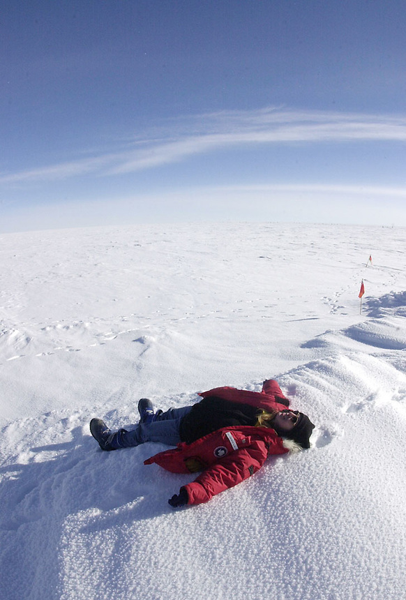 Astrophysicist Katherine Rawlins makes a snow angel on the vast featureless plain at Amundsen-Scott South Pole Station in Antarctica. Ernie Mastroianni photo.