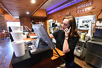 Employee Anita Moss takes a carry-out order called in on Tuesday March 24 2020 at Smokin' Joe's Ribhouse in Rogers. Go to nwaonline.com/200325Daily/ to see more photos. <br />(NWA Democrat-Gazette/Flip Putthoff)