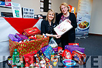 Claire Molloy Slimming World donating food to Mary Dolan of the Tralee Soup Kitchen.