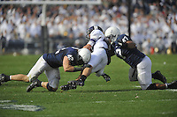 06 October 2012:  Penn State LB Michael Mauti (42) and Jordan Hill (47) hit a Northwestern WR. The Penn State Nittany Lions defeated the Northwestern Wildcats 39-28 at Beaver Stadium in State College, PA.
