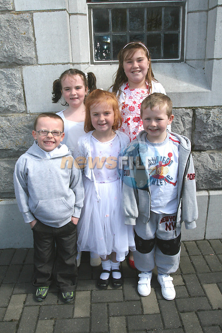 Roisin, Tara and Leah Mullen with Ben Kearney and Josh Duffy at the Communion in Duleek Church...Photo NEWSFILE/Jenny Matthews.(Photo credit should read Jenny Matthews/NEWSFILE)....This Picture has been sent you under the condtions enclosed by:.Newsfile Ltd..The Studio,.Millmount Abbey,.Drogheda,.Co Meath..Ireland..Tel: +353(0)41-9871240.Fax: +353(0)41-9871260.GSM: +353(0)86-2500958.email: pictures@newsfile.ie.www.newsfile.ie.FTP: 193.120.102.198.