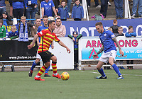 Scott McDonald looking to pass watched by Scott Mercer in the SPFL Ladbrokes Championship football match between Queen of the South and Partick Thistle at Palmerston Park, Dumfries on  4.5.19.