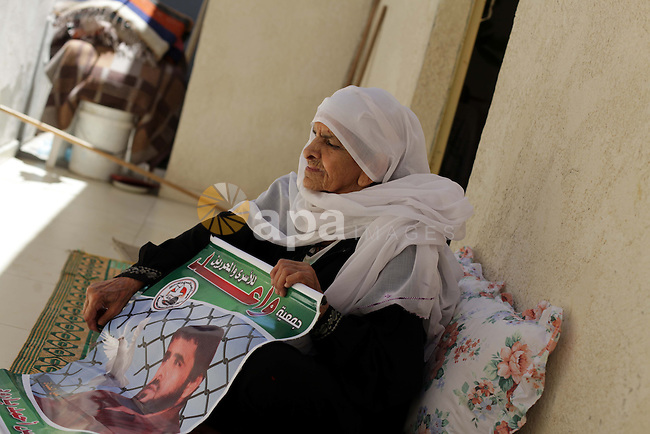 Rayya, mother of Palestinian Fares Baroud (picture), who has been held prisoner by Israel for 22 years, celebrates after hearing news on the possible release of her son in her house at Shati refugee camp in Gaza City July 28, 2013. Baroud was expected to be among more than 100 Arab prisoners to be released as a step to renew stalled peace talks with the Palestinians ahead of plans to convene negotiators in Washington later this week. Israeli ministers have yet to vote on the releases. Photo by Ashraf Amra