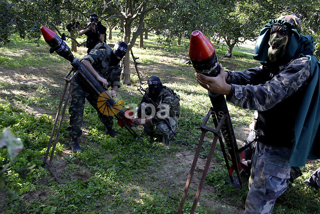 Palestinian militants from Al Nasser Brigades armed group fire home-made rockets during a training in the Gaza Strip, on Nov 5, 2009. The Brigades said that they expect a wide Israeli offensive on Gaza strip. Photo by Ashraf Amra
