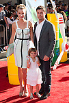 Ashley Scott and family arriving at the World Premiere of Planes held at El Capitan Theatre in Los Angeles, Ca. August 5, 2013.