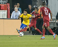 Portugal midfielder Ruben Amorim (20) tackles Brazil forward Neymar (10).  In an International friendly match Brazil defeated Portugal, 3-1, at Gillette Stadium on Sep 10, 2013.